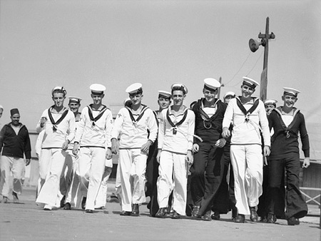22nd Jul 1940. HMAS Sydney (II) liberty men come ashore for well deserved leave.  (Photo: AWM 002432)